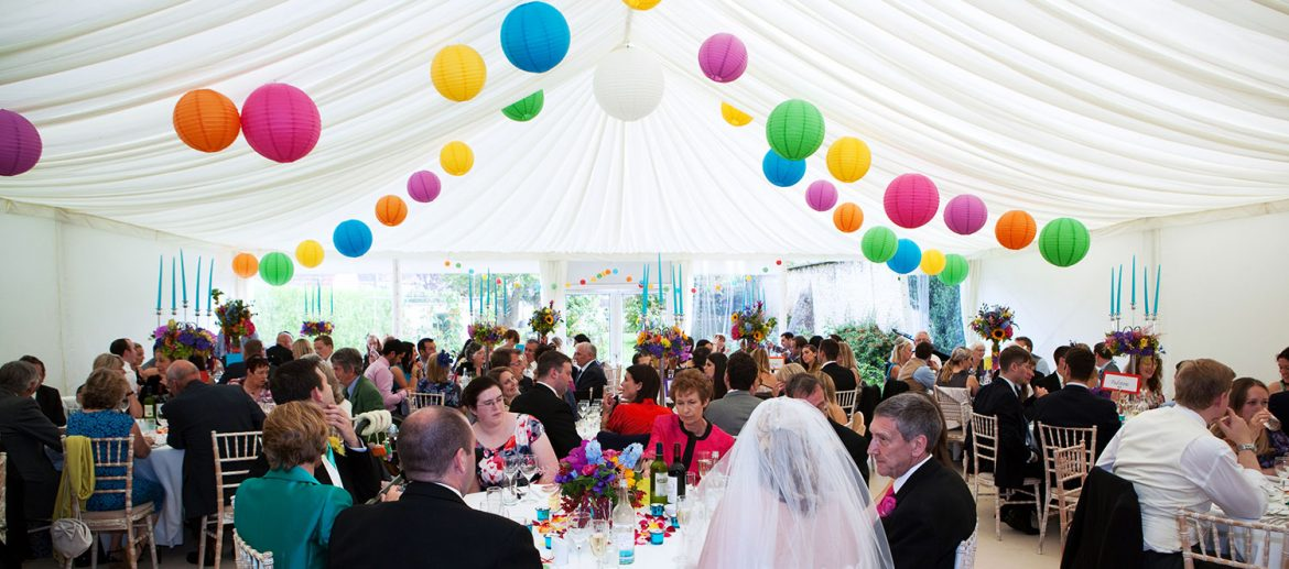 Decorated Wedding Marquee with Brightly Coloured Lanterns