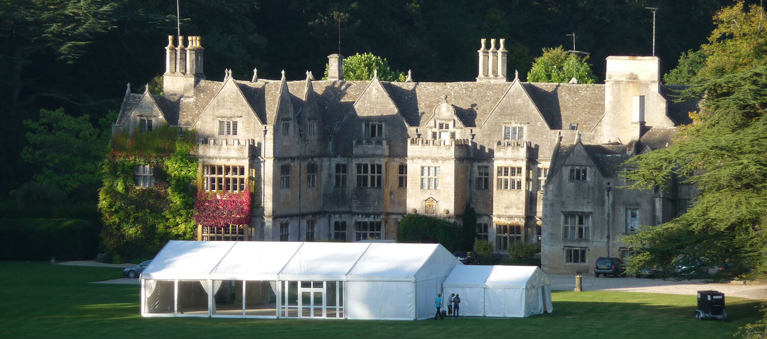 Huge Victorian mansion with a newly erected marquee in the grounds