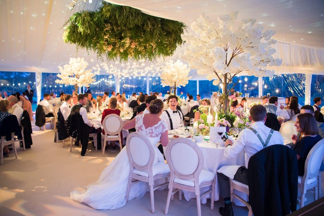 how we use ceiling decorations to improve the marquee wedding experience of its guests