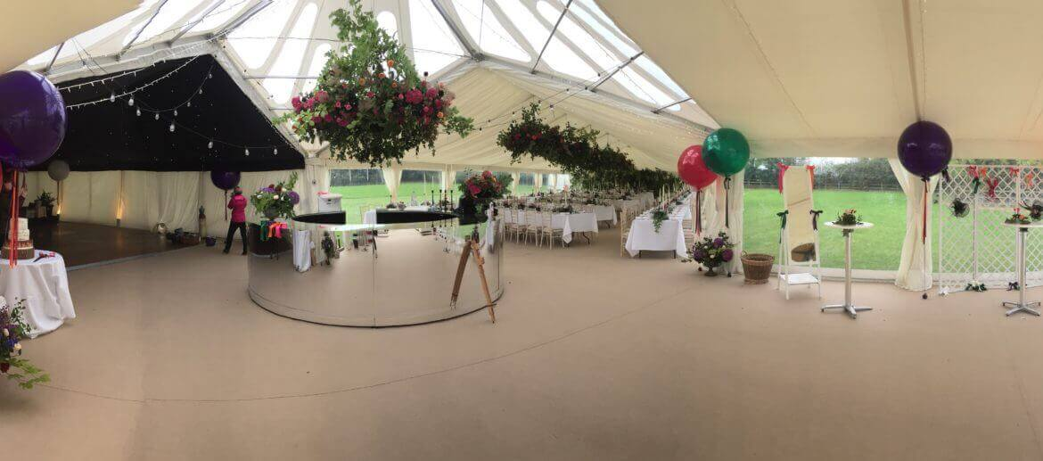 central hall area connecting three marquees for a large event in Wiltshire
