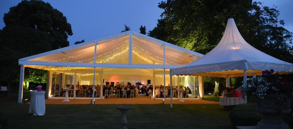 evening wedding party being held in a Marquee Vision large tent awing
